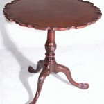Piecrust top tripod table.